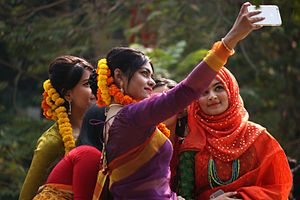 Pahela Falgun - Bangladeshi girls taking Selfie at Pahela Falgun festival.