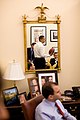 Barack Obama is reflected in a mirror in a David Axelrod 's office.jpg