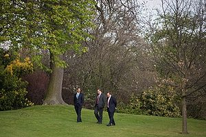 President Barack Obama walks the grounds at Wi...