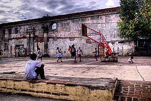 San Ignacio Church (Manila) - Youths playing basketball at the ruins of San Ignacio Church.