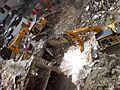 Beefy Excavators Destroying Old Building First II.jpg