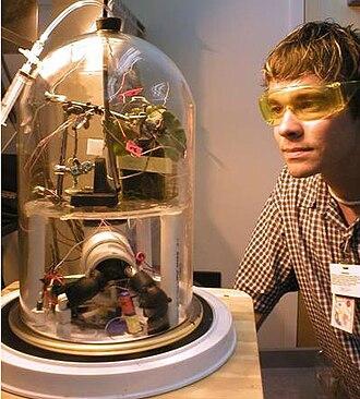 Bell jar - A bell jar operating below atmospheric pressure