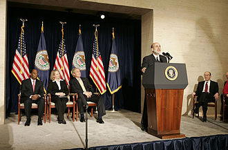 Ben Bernanke - With his predecessor, Alan Greenspan, looking on, Chairman Ben Bernanke addresses President George W. Bush and others after being sworn into the Federal Reserve post. Also on stage with the President are Mrs. Anna Bernanke and Roger W. Ferguson, Jr., Vice Chairman of the Federal Reserve.