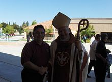 Bishop John Steinbock greets a fellow Knight of Columbus.jpg