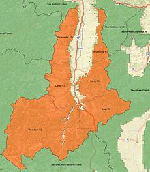 Una mappa panoramica di Bitterroot National Forest con i distretti ranger e le foreste che circondano l'etichetta