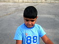 Blue clothed little cyclist boy - cycling near Nishapur railway station 06.JPG
