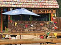 Blue porch umbrella at Sportsman's Bar in Alberton, Montana 2017.jpg