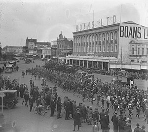 Boans - Boans c.1938. Includes brass band playing in street with crowd gathered to listen and The Grand Central Shaftesbury Hotel in the background.