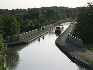 Milton Keynes grid road system - The Grand Union Canal passes over V6 Grafton Street between Bradville and New Bradwell on the modern Bradwell Aqueduct, built specifically to accommodate it.