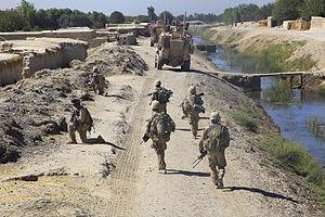 Nawa-I-Barakzayi District - Marines patrolling along one of the canals in Nawa-i-Barakzayi.