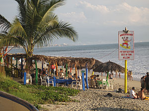 Bucerías, Nayarit - One of the beach front restaurants in Bucerías, with Puerto Vallarta in the background