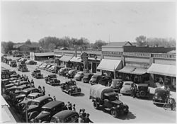 Parade of vehicles from Civilian Conservation Corps Camp BR-7 in Lovell, Wyoming