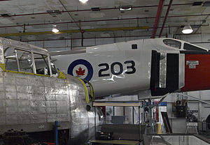 Canadian Air and Space Museum - Avro Lancaster being restored alongside the full-sized Avro Arrow replica