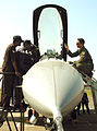 Capt. Kevin Jones gives a cockpit tour to IAF airmen during Cope India 2006.jpg