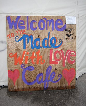 Emergency Communities - Sign outside tent where meals are served