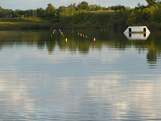 Water skiing - A privately owned, man-made water ski lake commonly referred to as Chantalyy Lakes By The Cliff Side, located near Orangeville, Ontario seen with a slalom course and jump ramp