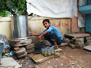 Wasim, a child labourer, works at a tea stall ...