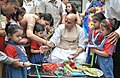 Children tying 'Rakhi' to the Union Home Minister, Shri Rajnath Singh, on the occasion of 'Raksha Bandhan', in New Delhi on August 18, 2016 (1).jpg