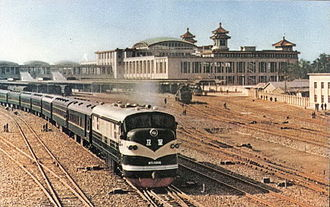 Beijing railway station - An NY1 diesel locomotive hauling a passenger train out of the Beijing Railway Station in 1959.