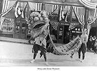1921 Chinese lion dance in front of the East Kong Yick Building