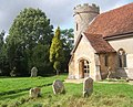 Churchyard, porch and little round tower - geograph.org.uk - 957839.jpg