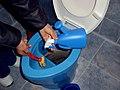 Cleaning UDDT (5935891139).jpg