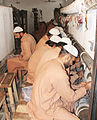 Correctional Activities in Central Jail Faisalabad, Pakistan in 2010 - Convicted prisoners busy in knitting Persian designs' carpets.jpg