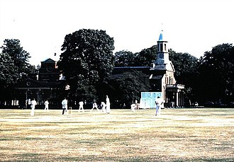 Kew Cricket Club - Cricket on Kew Green (1986), with St. Anne's Church in the background