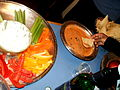 Crudités with a dip and bean dip with tortilla chips.jpg