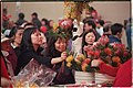 Customers eagerly buy fresh floral arrangements for Chinese New Year, 2004.jpg