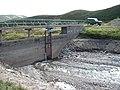 Dam with open sluice - geograph.org.uk - 1418242.jpg