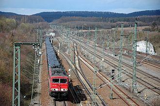 Württemberg Western Railway - Freight train running to Stuttgart near the entrance of the new Vaihingen (Enz) station; high-speed line on the right