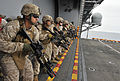 Defense.gov News Photo 110910-N-KS651-945 - U.S. Marines assigned to the 11th Marine Expeditionary Unit stand at the ready during a live-fire exercise aboard the amphibious assault ship USS.jpg