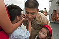 Defense.gov News Photo 110916-N-CZ945-173 - U.S. Navy Chief Petty Officer Kim Mercado has his chief petty officer anchors pinned on his collar by his son and daughter at the U.S. 7th Fleet.jpg