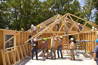 Tie (engineering) - Hurricane ties are in place at the top of the wall as the roof trusses are being placed.