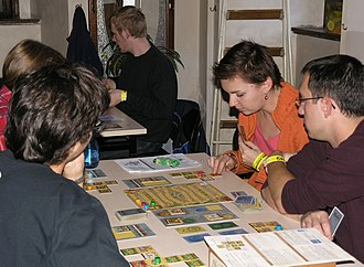 Alhambra (board game) - Players trade currencies and place tiles to build an Arabian palace