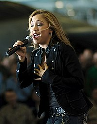 Diana DeGarmo performs for sailors during a United Service Organization (USO) show aboard the USS Theodore Roosevelt in the Persian Gulf. December 29, 2005.