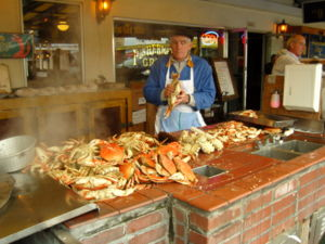 Tourists enjoy Dungeness Crabs at Fisherman's ...