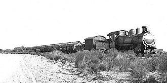 Wheatbelt railway lines of Western Australia - A WAGR E class steam locomotive hauling the first train of bulk wheat in Western Australia, 1931.