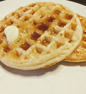 Eggo - Two Eggo toaster waffles with butter and syrup