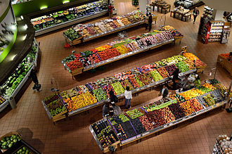 Supermarket - Consumers shopping for produce and fruit.