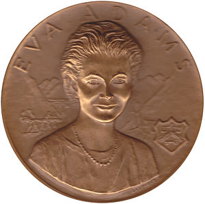 Kennedy half dollar - Mint Director Eva Adams, seen here on her medal (designed by Gasparro) was instrumental in the issuance of the Kennedy half dollar.