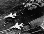 F8U-1s on USS Bon Homme Richard (CVA-31) before transcontinental flight 1957.jpg