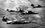 F9F-6 Cougars of VF-24 over Pearl Harbor 1953.jpg