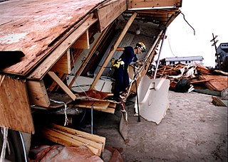 North Topsail Island, NC, September 6, 1996 -- An Urban Search and Rescue (USAR) Team inspects damaged and destroyed homes for reportedly missing people in the aftermath of Hurricane Fran. Photo by Dave Gatley/ FEMA News Photo