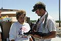 FEMA - 36954 - FEMA housing inspector talks to Iowa resident.jpg