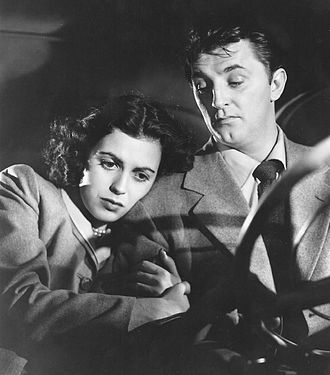 Faith Domergue - Domergue and Robert Mitchum in Where Danger Lives (1950).