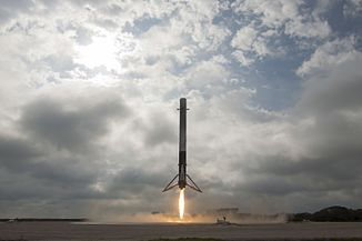 Falcon 9 first stage lands on LZ-1 (32153432924).jpg