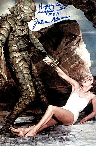 Creature from the Black Lagoon - Autographed Julie Adams still featuring the Creature menacing Kay.