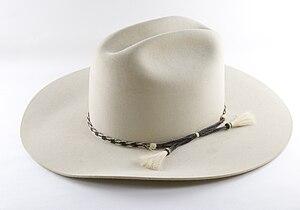 Felt beige cowboy hat on a white background